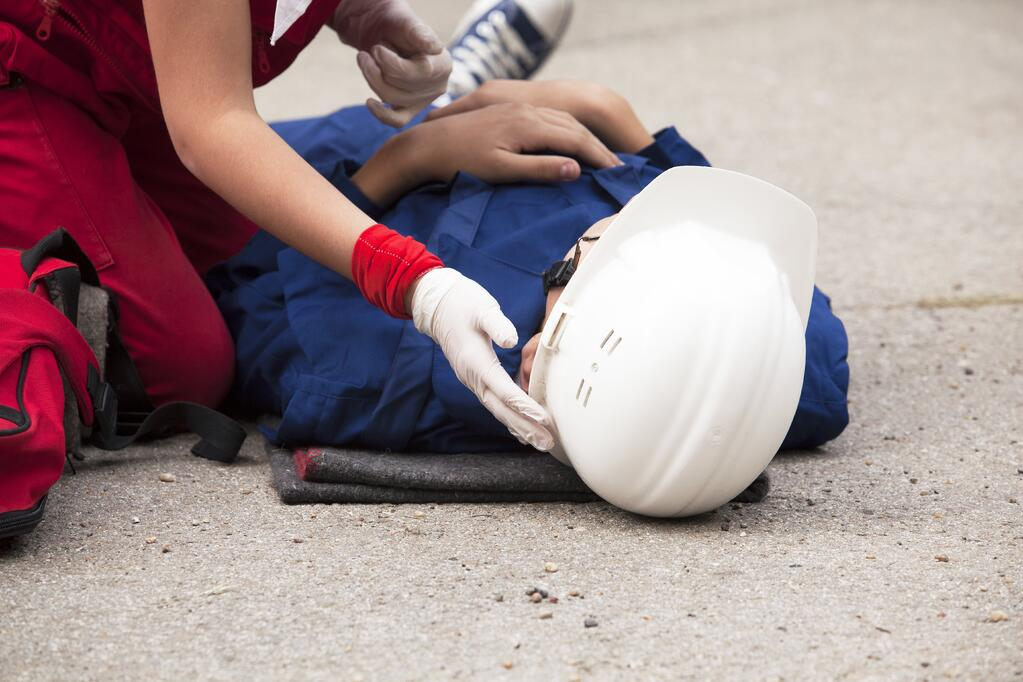 Worker receives first aid on the job
